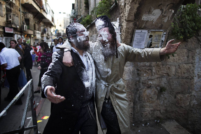 Ultra-Orthodox Jews celebrate the Jewish festival of Purim on February 25 2013 in the religious neighborhood of Mea Shearim in Jerusalem. Purim marks the deliverance of the Jewish people from a genocidal plot in ancient Persia, as recorded in the Biblical Book of Esther. (Photo by Menahem Kahana/AFP Photo)