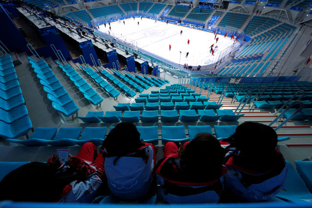 Volunteers watch from the topmost row as the men's ice hockey team from Germany practices at the PyeongChang 2018 Winter Olympics Gangneung Hockey Centre in Gangneung, South Korea, February 13, 2018. (Photo by Brian Snyder/Reuters)