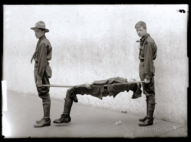 Three Boy Scouts Training Demonstration, photographed by Harris & Ewing in 1912.
