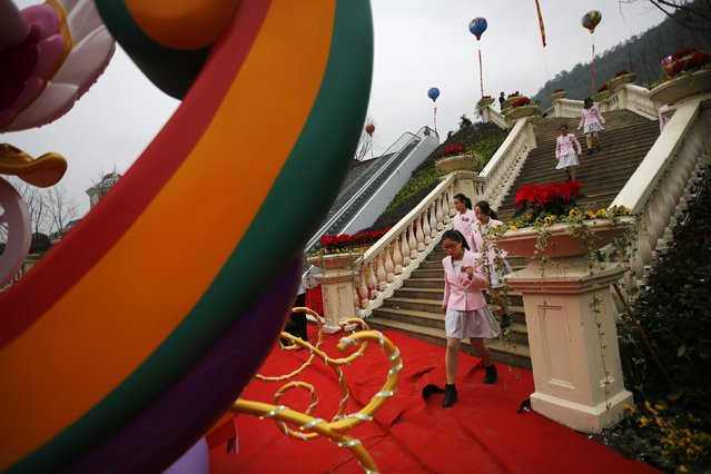 Attendants arrive at an inauguration ceremony of a Hello Kitty amusement park in Anji, Zhejiang province November 28, 2014. (Photo by Carlos Barria/Reuters)