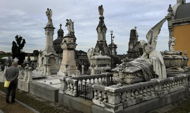 A man looks the pantheon of the Marquesa de San Juan de Nieva, chosen as the best tomb sculpture of Spain in a Spanish magazine this week, in the municipal cemetery of La Carriona in Aviles, northern Spain, October 29, 2015. (Photo by Eloy Alonso/Reuters)