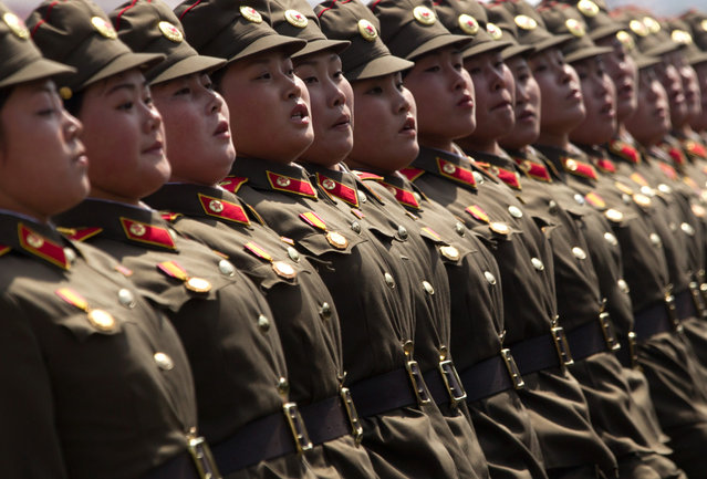Soldiers march in formation during a military parade in Pyongyang, on April 15, 2012. (Photo by Ed Jones/AFP Photo)
