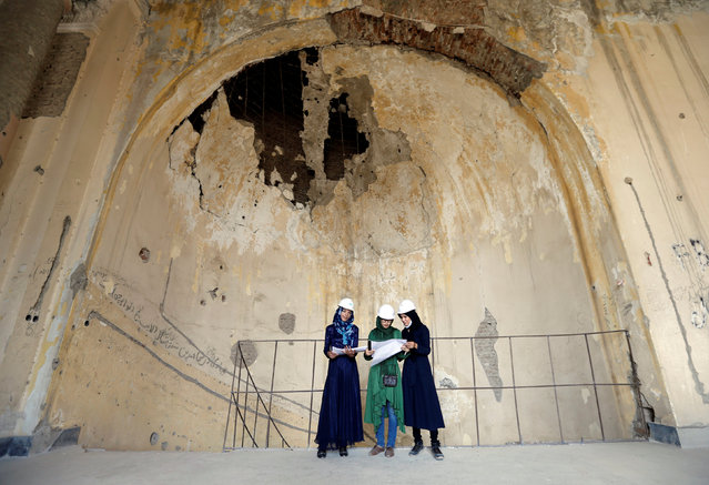 Afghan female engineers work on a map of the ruined Darul Aman palace in Kabul, Afghanistan October 2, 2016. (Photo by Mohammad Ismail/Reuters)