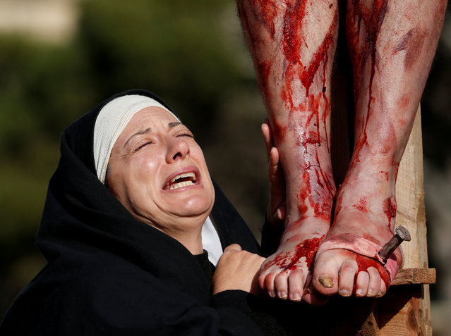 """An actor, portraying Mary, takes part in the interactive street-theatre Passion play """"Il-Mixja"""" (The Way), one of a series of Holy Week activities in the run-up to Easter, in the grounds of Mount Carmel Mental Hospital in Attard, Malta March 25, 2018. (Photo by Darrin Zammit Lupi/Reuters)"""