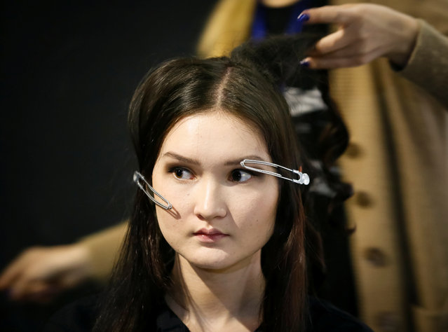 A model has her hair done in the backstage during Kazakhstan Fashion Week in Almaty, Kazakhstan April 11, 2018. (Photo by Shamil Zhumatov/Reuters)
