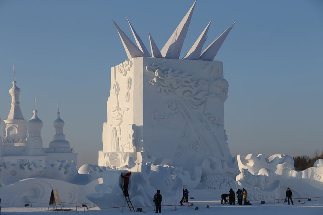 Sculptors work on a snow sculpture of Newton in the 16th Harbin Ice and Snow World, which will officially open on January 5 on December 22, 2014 in Harbin, China. (Photo by Feature China/Barcroft Media)