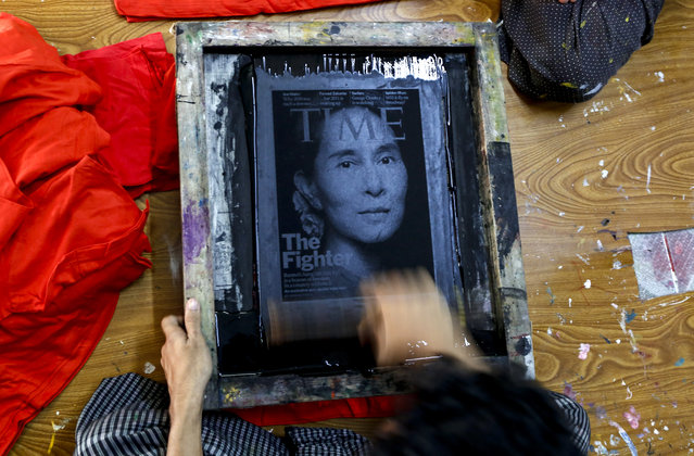A Myanmar screen printer inks a screen as he prints the image of Myanmar opposition leader Aung San Suu Kyi, chairperson of National League for Democracy (NLD) party, on t-shirts at a printing house in Yangon, Myanmar, November 13, 2015. (Photo by Lynn Bo BoEPA)