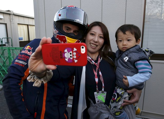 Honda MotoGP rider Marc Marquez (L) of Spain takes a selfie photo with Japanese fans at the paddock area at the Twin Ring Motegi circuit ahead of Sunday's Japanese Grand Prix in Motegi, north of Tokyo, Japan, October 8, 2015. (Photo by Issei Kato/Reuters)