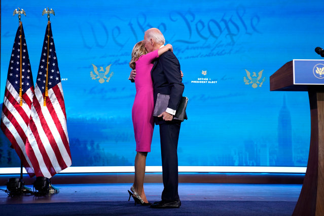 U.S. President-elect Joe Biden (R) embraces his wife Dr. Jill Biden after speaking about the Electoral College vote certification process at The Queen theater on December 14, 2020 in Wilmington, Delaware. On Monday, presidential electors of the Electoral College gathered in state capitals across the nation to cast their ballots for president and vice president. Their ballots will be formally counted during a joint session of Congress on January 6, 2021. (Photo by Drew Angerer/Getty Images)