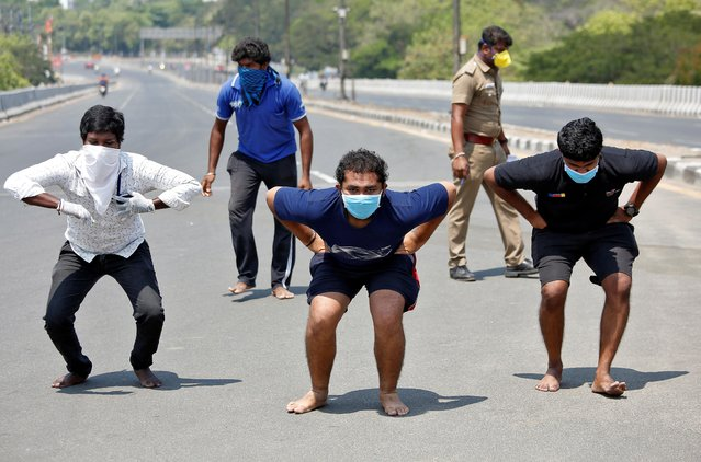 People squat barefoot as a punishment for breaking a lockdown imposed to slow the spreading of coronavirus disease (COVID-19) in Chennai, India, April 1, 2020. (Photo by P. Ravikumar/Reuters)