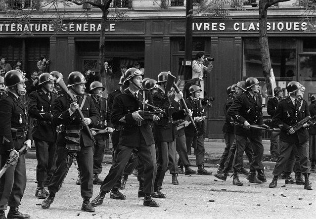 Armed riot police prepare for confrontation with  student protesters, Boulevard Saint Germain , Paris, France, May 6, 1968. (Photo by Gökşin Sipahioğlu/SIPA Press)