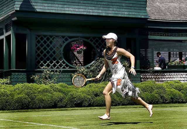 Newly inducted Tennis Hall of Famer Martina Hingis plays barefoot tennis on a show court adjacent to the Hall of Fame Tennis Museum in Newport, R.I., on July 14, 2013. (Photo by Elise Amendola/Associated Press)