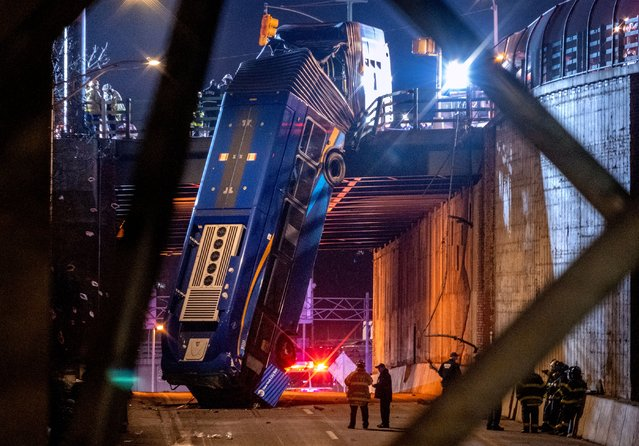 A bus in New York City which careened off a road in the Bronx neighborhood of New York is left dangling from an overpass Friday, January 15, 2021, after a crash late Thursday that left the driver in serious condition, police said. (Photo by Craig Ruttle/AP Photo)