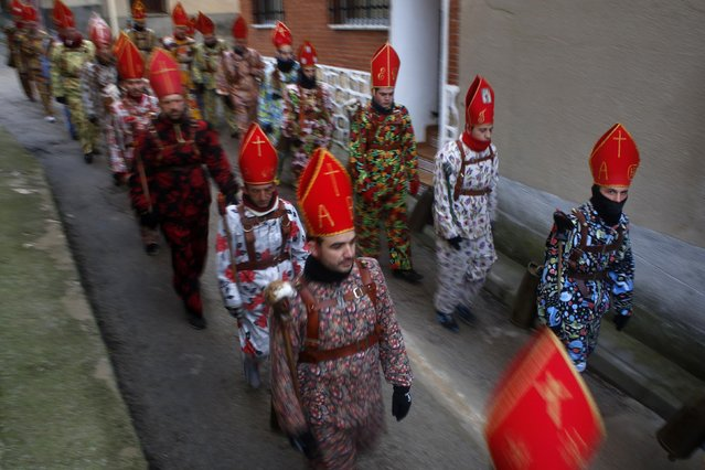 """Believers parade around town during the """"Endiablada"""" festival in Almonacid del Marquesado, in central Spain February 3, 2015. (Photo by Susana Vera/Reuters)"""
