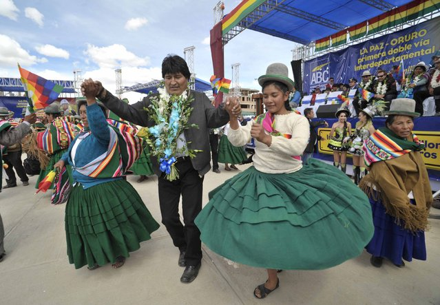 Bolivia's President Evo Morales dances during a ceremony near Oruro, February 2, 2015. President Morales inaugurated on Monday a highway that links La Paz to Oruro, a distance of approximately 210 km. (Photo by Reuters/ABI/Bolivian Presidency)