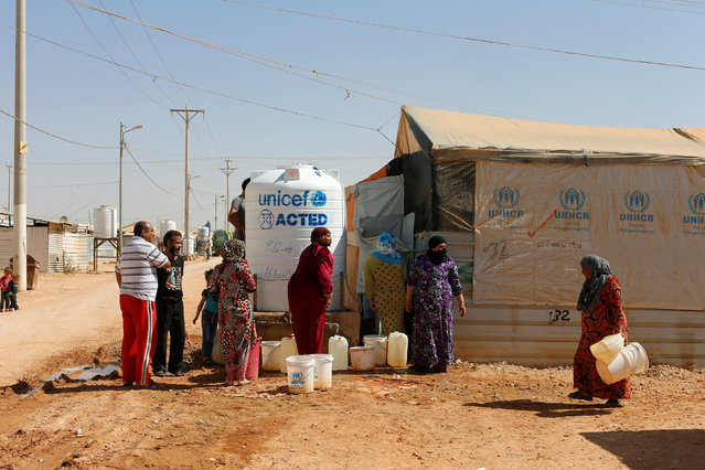 Syrian refugees collect water in Zaatari refugee camp near the border with Syria, in Mafraq, Jordan October 14, 2016. (Photo by Ammar Awad/Reuters)