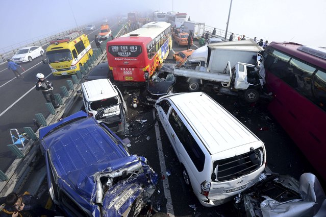 Damaged vehicles are seen on Yeongjong Bridge in Incheon February 11, 2015. A traffic pileup involving more than 100 vehicles on the bridge on Wednesday killed at least two people and injured more than 30 people, according to local news reports. (Photo by Park Jung-ho/Reuters/News1)