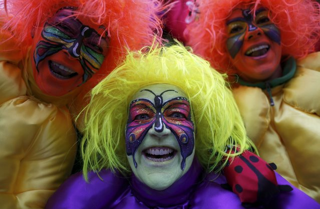"Women dressed in costumes for ""Weiberfastnacht"" (Women's Carnival) celebrate in Cologne February 12, 2015. Women's Carnival marks the start of a week of street festivals, the highlight of the event being ""Rosenmontag"" (Rose Monday), the final day of the carnival where mass processions are held. (Photo by Ina Fassbender/Reuters)"