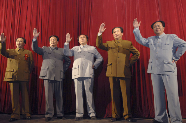 """Impersonators of China's late Chairman Mao Zedong pose on a stage during the rehearsal of a drama entitled """"The Red Sun Rises in Shaoshan"""" in Hunan province, December 21, 2008. (Photo by Reuters/Stringer)"""