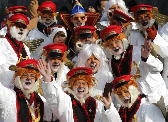 Revellers dressed as foxes cheer during the traditional Rose Monday carnival parade in Duesseldorf, Germany, Monday, February 16, 2015. (Photo by Frank Augstein/AP Photo)