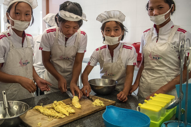 Children take part in a cookery lesson at Songdowon International School Children's Camp on August 22, 2018 in Wonsan, North Korea. (Photo by Carl Court/Getty Images)