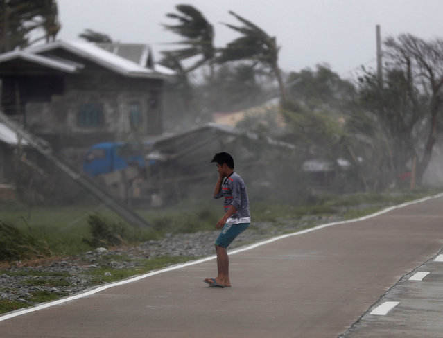 Strong winds batters a villager in the typhoon-hit town of Baggao, Cagayan province, Philippines, 15 September 2018. Mangkhut, the most powerful typhoon to hit the Philippines in the last five years, has weakened slightly after its passage through the northern part of the country, with sustained winds of 170 kilometers per hour and gusts of up to 260 kilometers per hour without any reports of casualties so far, authorities said. Over 50,000 people in all regions expected to be struck by the typhoon have been evacuated although over 5.2 million Filipinos living in a 125 kilometer radius from Mangkhut's trajectory will feel its impact, according to the National Disaster Risk Reduction and Management Council. (Photo by Francis R. Malasig/EPA/EFE)