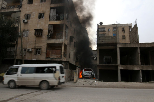 Smoke rises from a car after strikes on the rebel-held besieged al-Zebdieh district, in Aleppo Syria December 5, 2016. (Photo by Abdalrhman Ismail/Reuters)