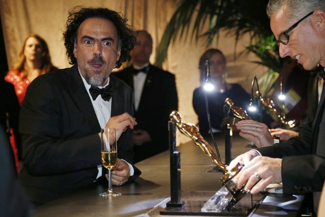 Director Alejandro Gonzalez Inarritu watches as his Oscars for best picture, best director and best original screenplay are engraved at the Governors Ball at the 87th Academy Awards in Hollywood, California February 22, 2015. (Photo by Mario Anzuoni/Reuters)