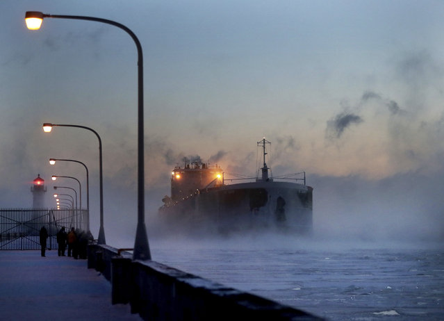 Steam rises from Lake Superior as the ship St. Clair comes to harbor during some of the coldest temps of the year, Sunday, December 31, 2017, at Canal Park in Duluth, Minn. The St. Clair is a self-unloader built in 1976 at Sturgeon Bay, Wis., and is 770 feet long and has 26 hatches that open into 5 cargo holds, providing a load capacity of 45,000 tons. (Photo by David Joles/Star Tribune via AP Photo)
