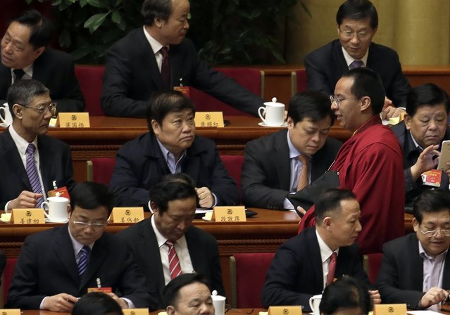 Gyaltsen Norbu, the 11th Panchen Lama, walks during the opening session of the Chinese People's Political Consultative Conference (CPPCC) at the Great Hall of the People in Beijing, March 3, 2015. REUTERS/Jason Lee