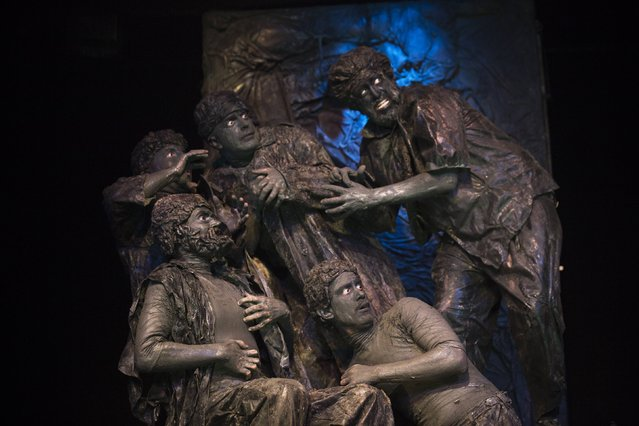 "Actors from the Israeli theatre group Orto-Da perform during their show titled ""Stones"", at a theatre in Tel Aviv March 10, 2015. Inspired by Nathan Rapoport's Warsaw Ghetto Uprising Monument, the play tells a story from the point of view of the sculptures in the monument. (Photo by Amir Cohen/Reuters)"