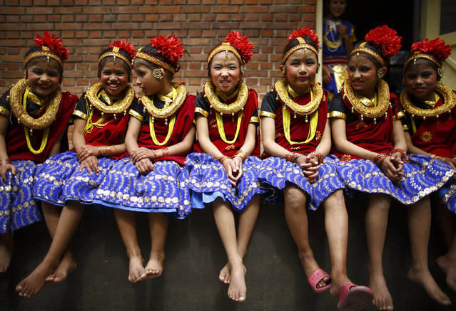 Girls, in traditional attire, take part in a function organized to mark International Women's Day at Maiti Nepal in Kathmandu March 8, 2015. (Photo by Navesh Chitrakar/Reuters)