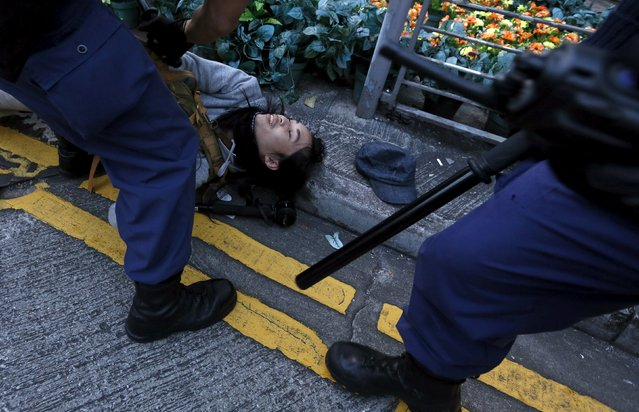 Riot police arrests a protester after a clash at Mongkok district in Hong Kong, China February 9, 2016. (Photo by Bobby Yip/Reuters)