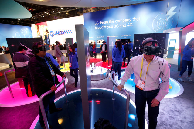 Attendees try out VR headsets at the Qualcomm booth during the 2017 CES in Las Vegas, Nevada January 6, 2017. (Photo by Steve Marcus/Reuters)