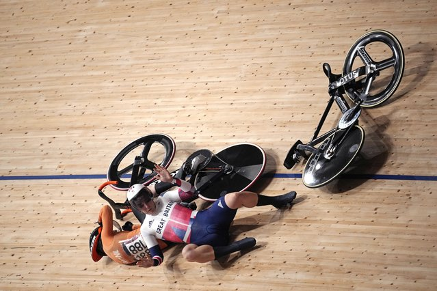 Katy Marchant of Team Great Britain crashes with Laurine van Riessen of Team Netherlands (188) during the track cycling women keirin at the 2020 Summer Olympics, Thursday, August 5, 2021, in Izu, Japan. (Photo by Christophe Ena/AP Photo)