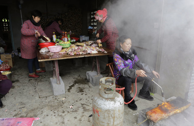 Locals prepare a traditional ethnic Tujia wedding feast for about 2000 guests during celebrations marking the Lunar New Year, in Ziqiu town, Changyang county of China's Hubei province, February 14, 2016. (Photo by Jason Lee/Reuters)