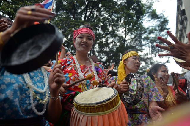 Members of the Thai community perform music to celebrate the Songkran festival in Hong Kong on April 12, 2015. (Photo by Dale de la Rey/AFP Photo)