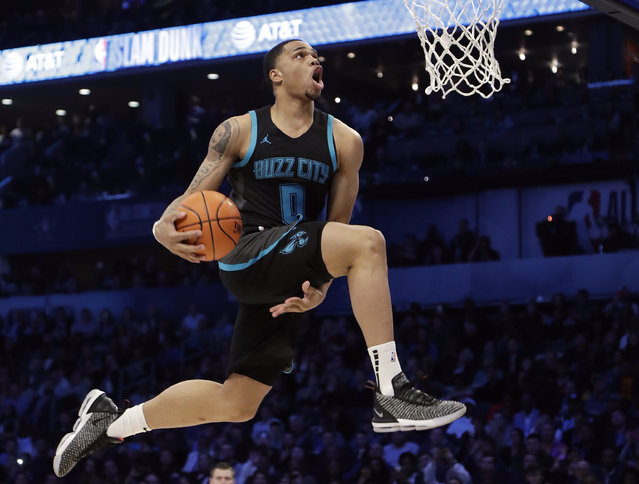 Charlotte Hornets Miles Bridges heads to the hoop during the NBA All-Star Slam Dunk contest, Saturday, February 16, 2019, in Charlotte, N.C. (Photo by Chuck Burton/AP Photo)