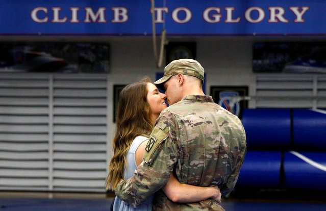Cpl Preston Dyce, a soldier with the 4th Battalion, 31st Infantry Regiment, 2nd Brigade Combat Team of the 10th Mountain Division, is greeted by his wife Michaela Dyce upon his return home from deployment in Afghanistan, at Fort Drum, New York, September 6, 2021. (Photo by Brendan McDermid/Reuters)