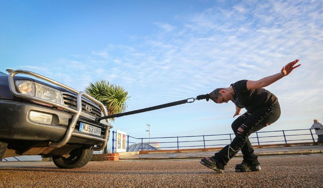 Circus of Horrors performer Anastasia IV pulls a four tonne vehicle along the seafront in Eastbourne, Sussex, as the circus prepare to perform a series of shows across the region later this month, on January 7, 2014. (Photo by Gareth Fuller/PA Wire)