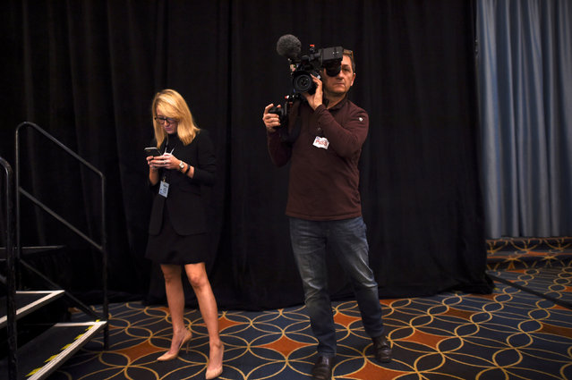 """(L-R) Kathryn McQuade, the Media Affairs and Events Coordinator from the House Republican Conference, checks her smartphone while a videographer films before the 2017 """"Congress of Tomorrow"""" Joint Republican Issues Conference in Philadelphia, Pennsylvania, U.S. January 26, 2017. (Photo by Mark Makela/Reuters)"""