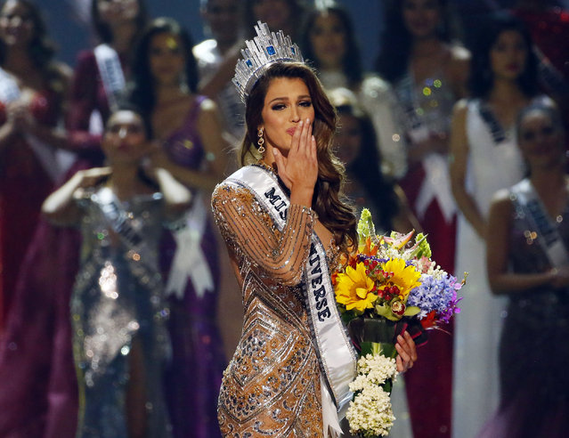 Iris Mittenaere of France blows kisses to the crowd after being proclaimed the new Miss Universe 2016 in coronation Monday, January 30, 2017, at the Mall of Asia in suburban Pasay city, south of Manila, Philippines. (Photo by Bullit Marquez/AP Photo)