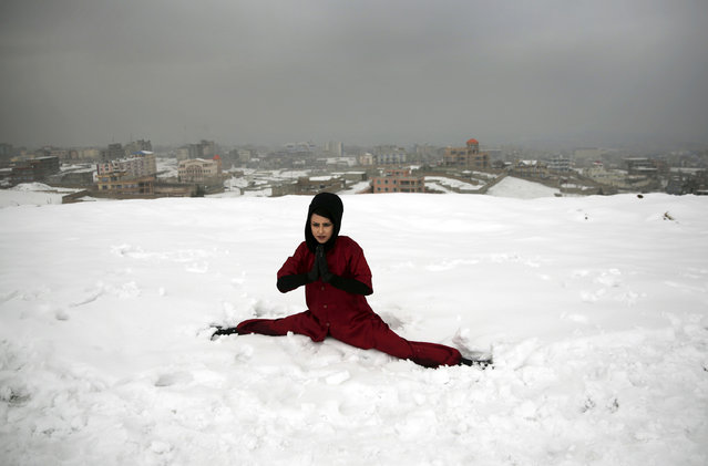 A Shaolin martial arts student practices the splits on a hilltop in Kabul, Afghanistan, Tuesday, January 25, 2017. In religiously conservative Afghanistan, girls are often discouraged from aggressive sports. (Photo by Massoud Hossaini/AP Photos)