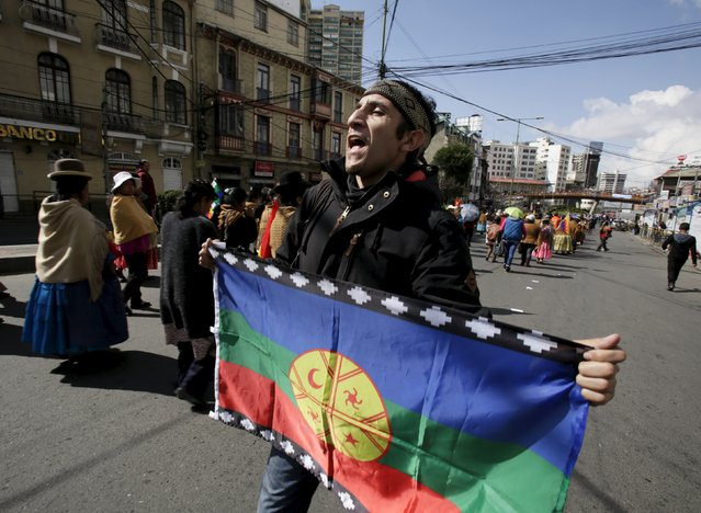 A member of the Mapuche ethnic group from Chile participates in a rally commemorating International Workers' Day in La Paz May 1, 2015. International Workers' Day, also known as Labour Day or May Day, commemorates the struggle of workers in industrialised countries in the 19th century for better working conditions. (Photo by David Mercado/Reuters)
