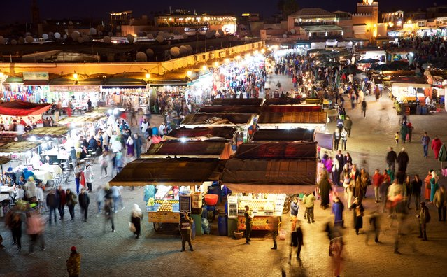 """The hustle and bustle of the famous Jemaa el-Fnaa in Marrakech, seen from a cafe rooftop"". (Photo by Roslin Zuha/The Guardian)"