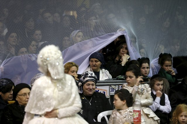 Ultra-Orthodox Jewish women sit next to the bride as they attend her wedding ceremony, in Netanya, Israel early March 16, 2016. (Photo by Baz Ratner/Reuters)
