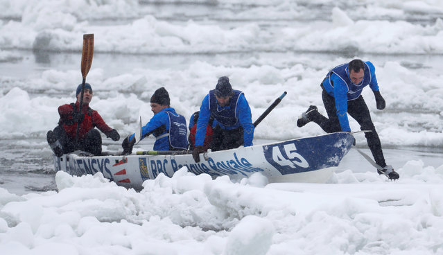 Team RBC Banque Royal competes during the Ice Canoe race at the Quebec Winter Carnival in Quebec City, February 5, 2017. (Photo by Mathieu Belanger/Reuters)
