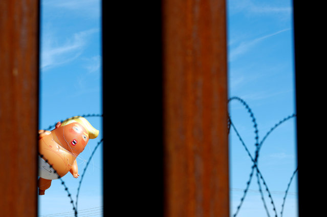 "A ""Baby Trump"" balloon floating during a protest against U.S. President Donald Trump visit to Calexico, California, as seen from Mexicali, Mexico on April 5, 2019. (Photo by Carlos Jasso/Reuters)"