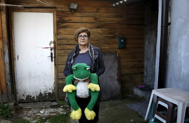 "Hava Dautbasic, mother of killed ten-year-old boy Dzevad, poses with his toy at the place where he was killed, in Sarajevo, March 18, 2016. He was killed on October 10, 1992 by a grenade in a yard near his house where children were playing. U.N. tribunal will hand down next week the verdict in Bosnian Serb leader Radovan Karadzic's trial for genocide. Dautbasic said, ""I hope that Karadzic will be convicted and that he will never get out of a prison. Dungeon is for him, nothing else. But I doubt everything will be as we hope"". (Photo by Dado Ruvic/Reuters)"