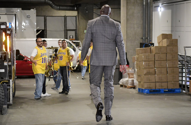 Magic Johnson walks toward members of the Los Angeles Lakers' band as he leaves the building prior to an NBA basketball game between the Lakers and the Portland Trail Blazers on Tuesday, April 9, 2019, in Los Angeles. Johnson abruptly quit as the Lakers' president of basketball operations Tuesday night, citing his desire to return to the simpler life he enjoyed as a wealthy businessman and beloved former player before taking charge of the franchise just over two years ago. (Photo by Mark J. Terrill/AP Photo)